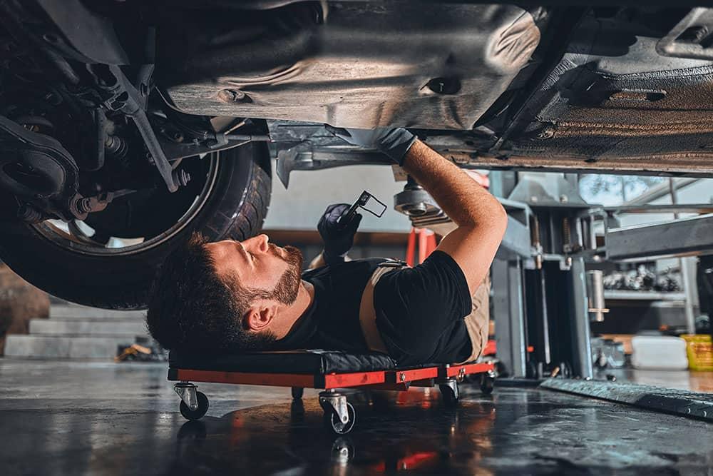 worker servicing car