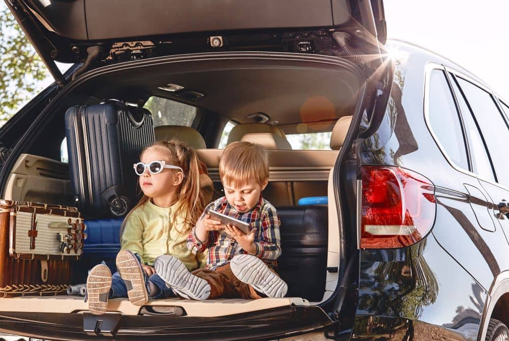 Kids and luggage in the car.